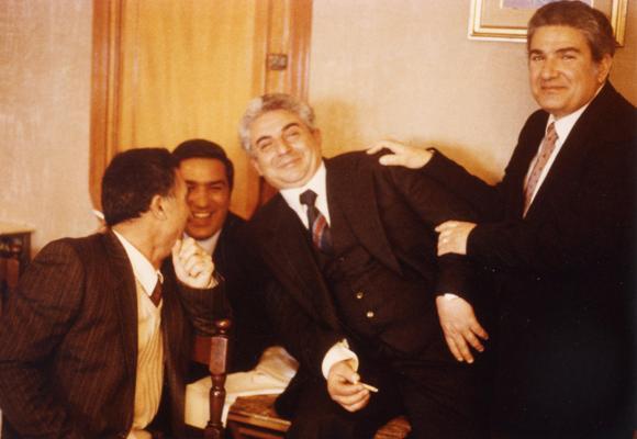 Al centro, l'avvocato Buscarino